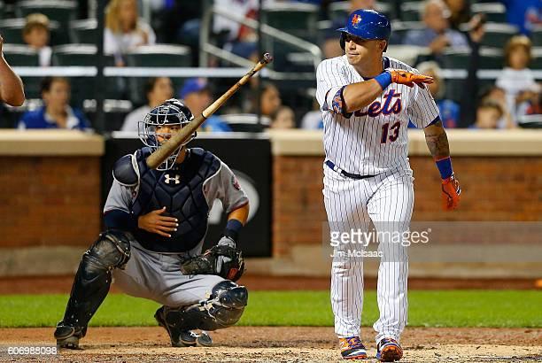 Asdrubal Cabrera of the New York Mets flips his bat after his third inning home run as Kurt Suzuki of the Minnesota Twins looks on at Citi Field on...