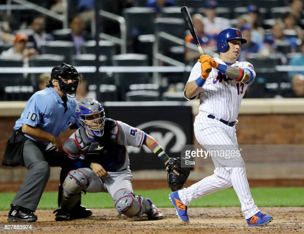 Asdrubal Cabrera of the New York Mets hits an RBI double in the seventh inning as Robinson Chirinos of the Texas Rangers defends during interleague...