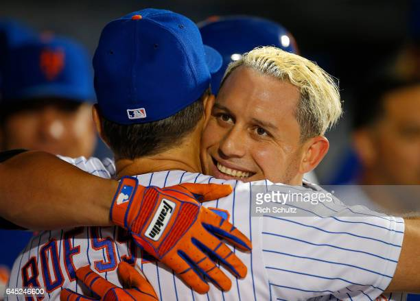 Asdrubal Cabrera of the New York Mets hugs assistant hitting coach Pat Roessler after he hit a two run home run in the ninth inning of a game against...