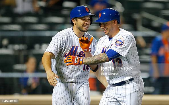 Asdrubal Cabrera of the New York Mets is congratulated by Travis d'Arnaud after he hit a two run home run in the ninth inning of a game against the...