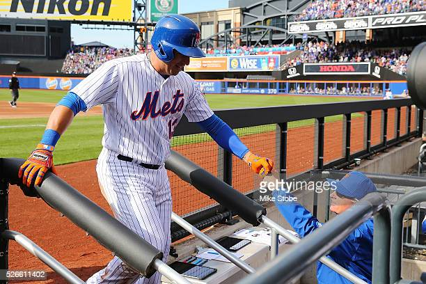 Asdrubal Cabrera of the New York Mets is greeted by manager Terry Collins after scoring on Michael Conforto tworun double against the San Francisco...