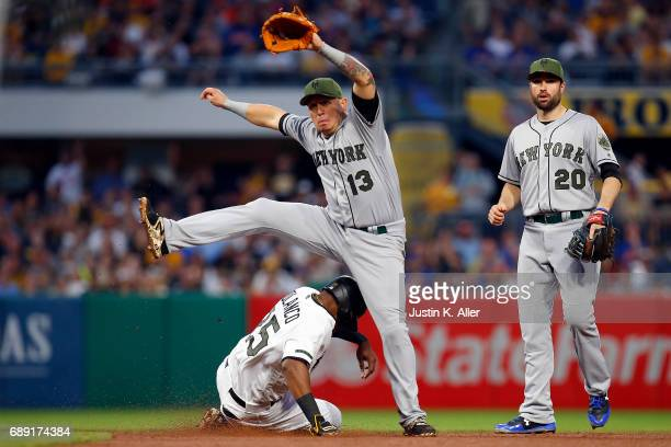 Asdrubal Cabrera of the New York Mets turns a double play in the fourth inning against the Pittsburgh Pirates at PNC Park on May 27 2017 in...