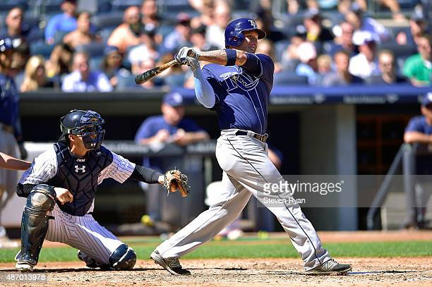 Asdrubal Cabrera of the Tampa Bay Rays hits a hits a two RBI single against the New York Yankees at Yankee Stadium on September 5 2015 in New York...