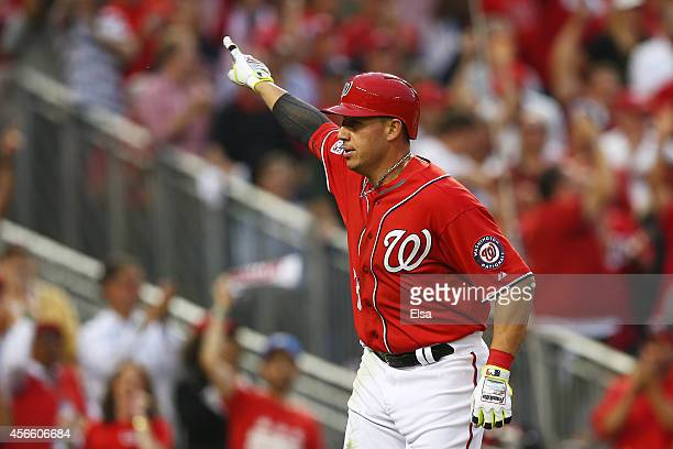 Asdrubal Cabrera of the Washington Nationals celebrates his in the seventh inning home run during Game One of the National League Division Series...