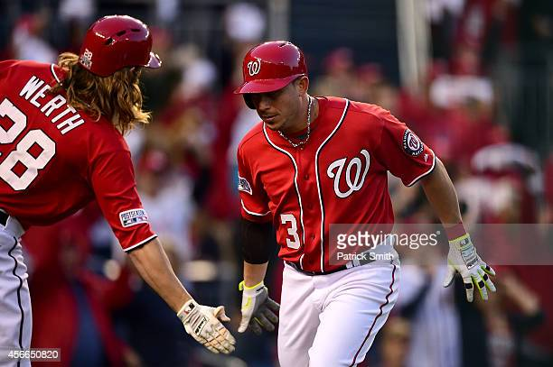 Asdrubal Cabrera of the Washington Nationals celebrates with teammate Jayson Werth after scoring on a single to left field hit by Anthony Rendon in...