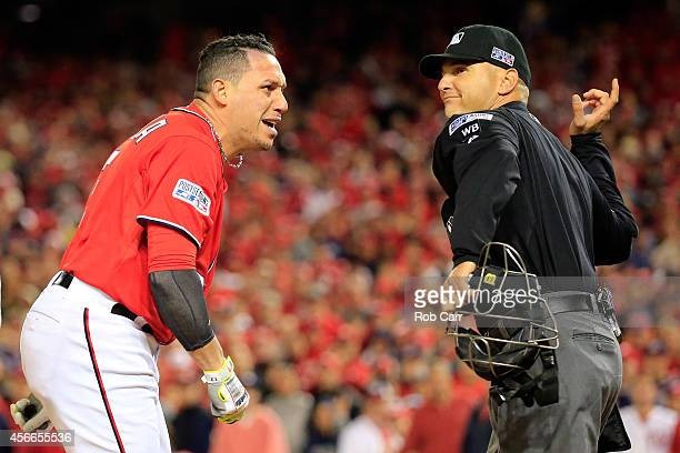 Asdrubal Cabrera of the Washington Nationals gets ejected by home plate umpire Vic Carapazza after arguing a strike call in the tenth inning against...