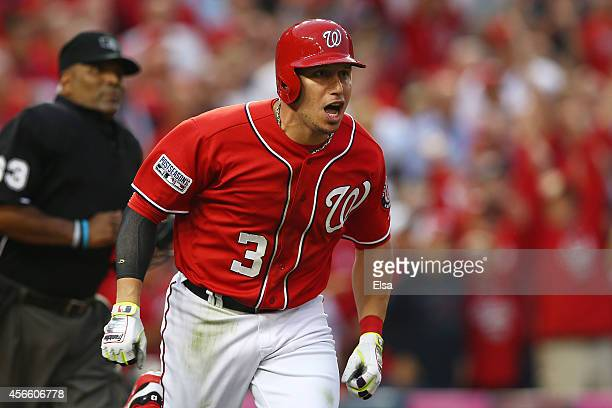 Asdrubal Cabrera of the Washington Nationals reacts to his seventh inning home run during Game One of the National League Division Series against the...