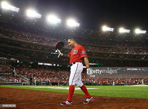 Asdrubal Cabrera of the Washington Nationals walks to the dugout after grounding out in the ninth inning against the San Francisco Giants during Game...