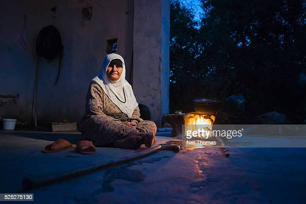 Ase Alokmen the mother of a PKK guerilla sits on the roof of her home in the village of Delav The village was destroyed in 1993 and she subsequently...
