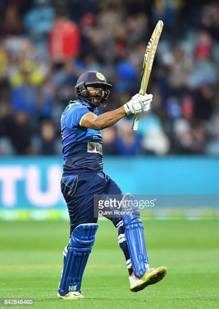 Asela Gunaratne of Sri Lanka celebrates hitting the winning runs to win the second International Twenty20 match between Australia and Sri Lanka at...