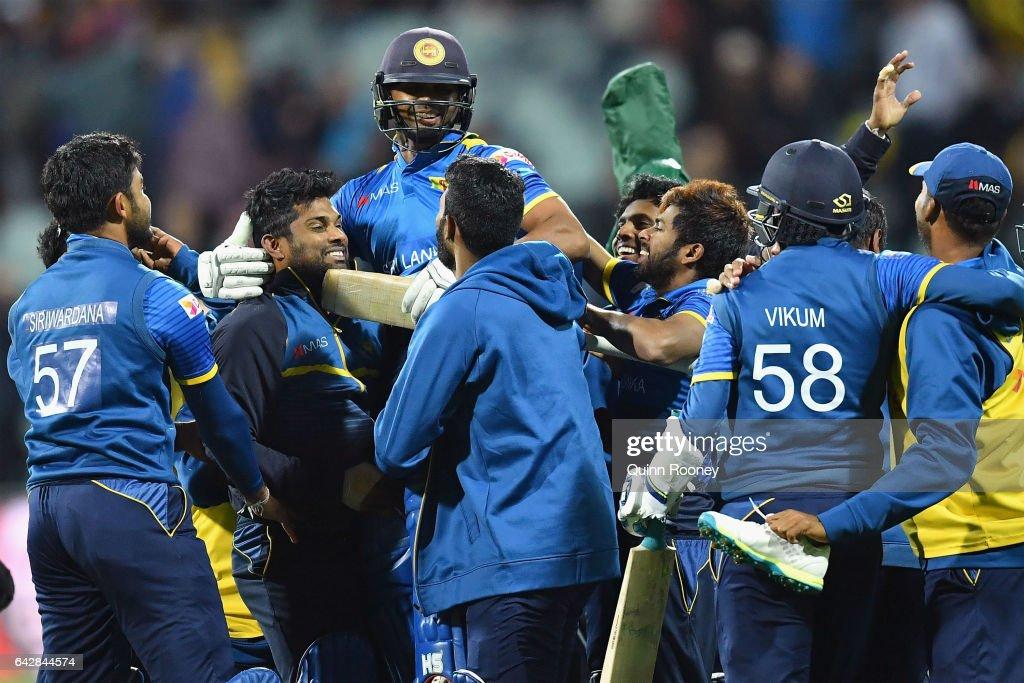 Asela Gunaratne of Sri Lanka is congratulated by team mates after hitting the winning runs to win the second International Twenty20 match between Australia and Sri Lanka at Simonds Stadium on February 19, 2017 in Geelong, Australia.