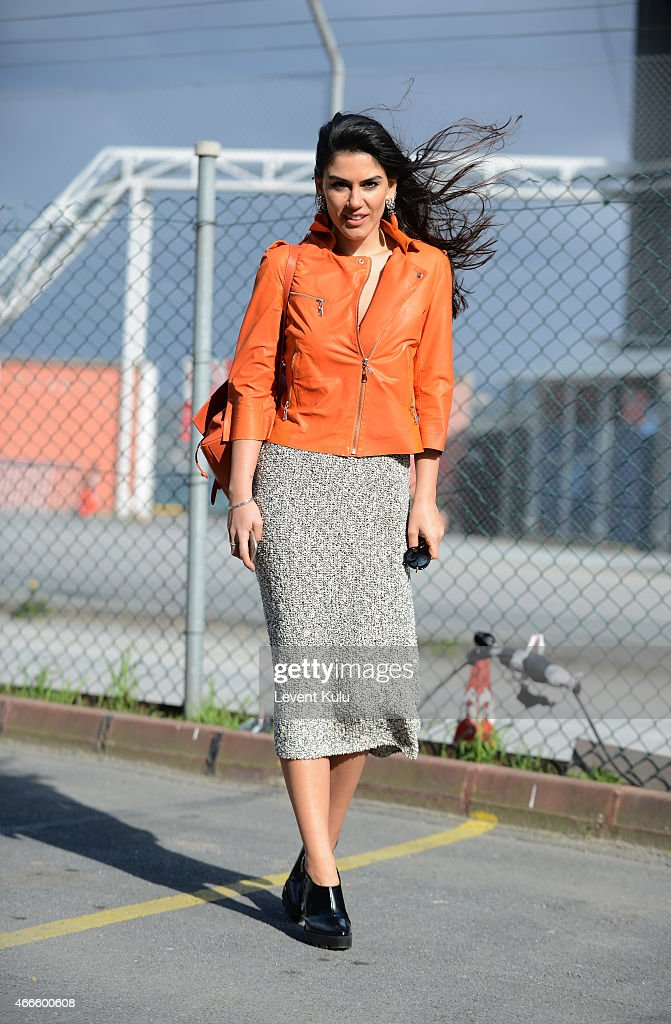 Asena Ozbatur poses wearing by jacket by Nazli Bozdag dress by Zara hand bag by Kiaora and an earring by Monreve during Mercedes Benz Fashion Week...