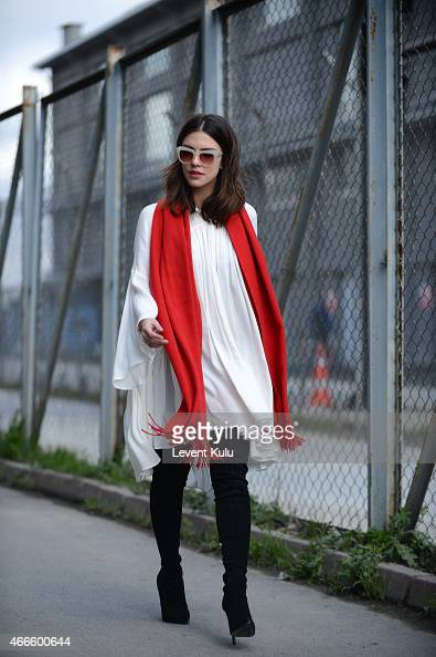 Asena Ozbatur poses wearing jacket by Nazli Bozdag dress by Zara hand bag by Kiaora and an earring by Monreve during Mercedes Benz Fashion Week...