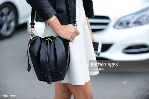 Asena Saribatur poses wearing a jacket by Vogue and a hang bag by Kiaora during Mercedes Benz Fashion Week Istanbul FW15 on March 16 2015 in Istanbul...