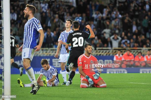 Asensio of Real Madrid celebrates with teammates after scoring during the Spanish league football match between Real Sociedad and Real Madrid at the...