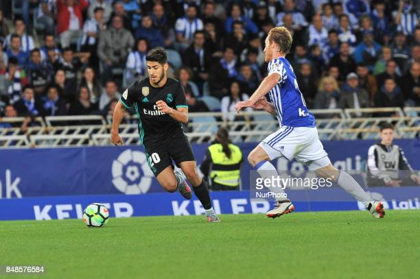 Asensio of Real Madrid duels for the ball with 17ltof Real Sociedad during the Spanish league football match between Real Sociedad and Real Madrid at...