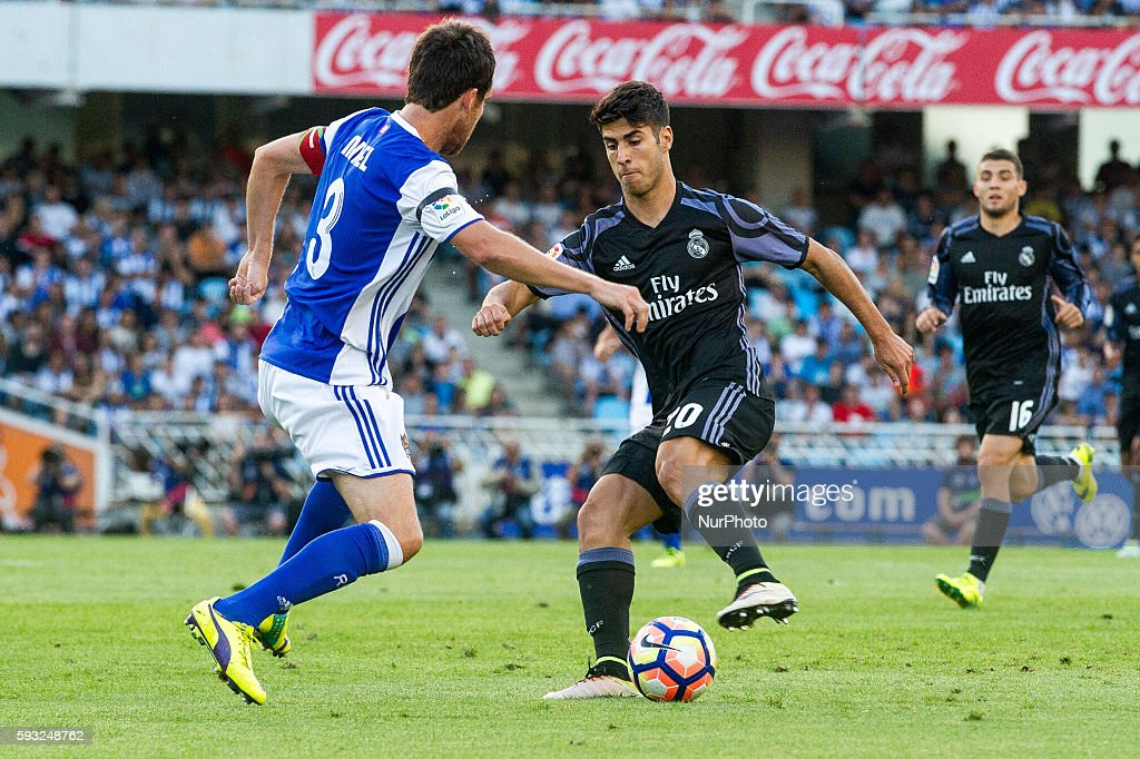 Asensio of Real Madrid duels for the ball with Mikel Gonzalez of Real Sociedad during the Spanish league football match between Real Sociedad and...