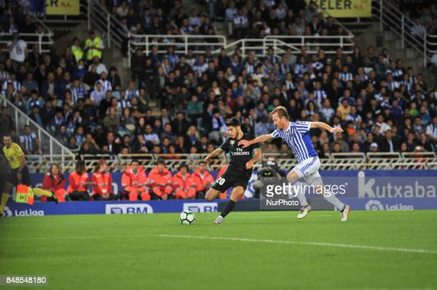 Asensio of Real Madrid duels for the ball with Zurutuza of Real Sociedad during the Spanish league football match between Real Sociedad and Real...