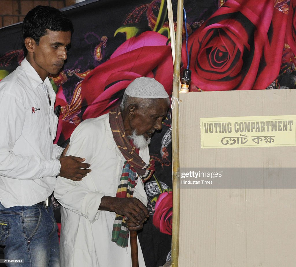 Asgar Ali 103 years old enclave dweller casting his vote for the first time at Maddhya Mashaldanga, Chhitmahal on May 5, 2016 in Coochbehar, India. More than 9,800 of the 10,100 eligible voters in former Bangladeshi enclaves of West Bengals Cooch Behar have enrolled for the voter list, signalling exceptional enthusiasm among the people who became Indian citizens less than nine months ago. These people have lived in a virtual no-mans land for 68 years because of a complex territorial division, which created enclaves or islands of foreign territory inside each country along the Indo-Bangladesh border. The two countries agreed in 2015 to swap the almost 200 enclaves located in one country but officially belonging to the other.