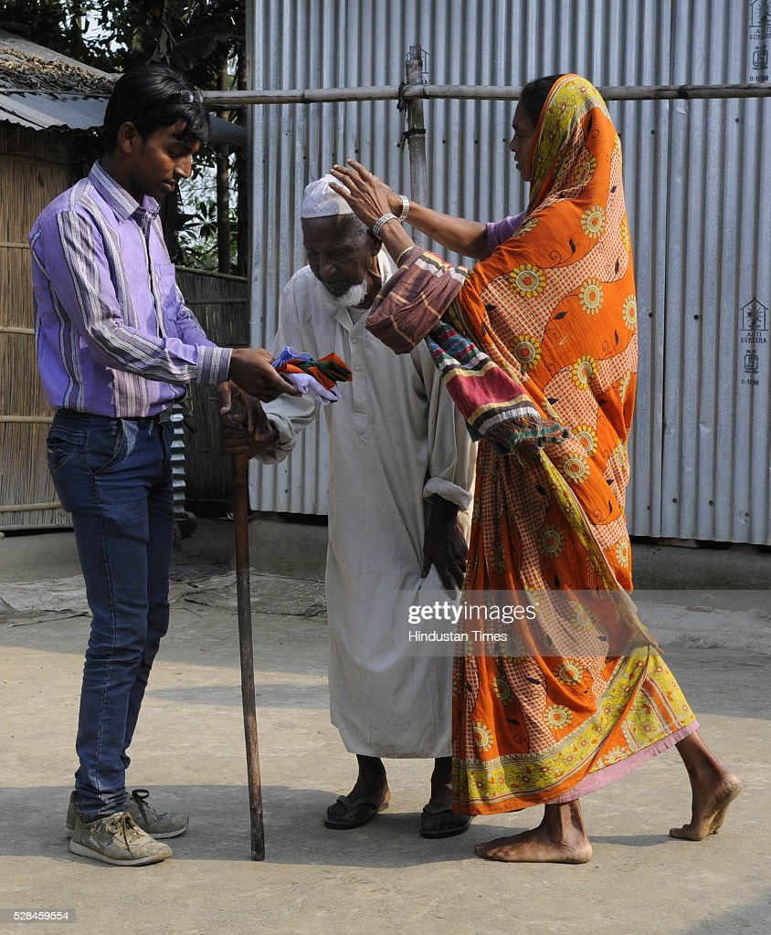 Asgar Ali 103 years old enclave dweller getting dressed to caste his vote for the first time at Maddhya Mashaldanga, Chhitmahal on May 5, 2016 in Coochbehar, India. More than 9,800 of the 10,100 eligible voters in former Bangladeshi enclaves of West Bengals Cooch Behar have enrolled for the voter list, signalling exceptional enthusiasm among the people who became Indian citizens less than nine months ago. These people have lived in a virtual no-mans land for 68 years because of a complex territorial division, which created enclaves or islands of foreign territory inside each country along the Indo-Bangladesh border. The two countries agreed in 2015 to swap the almost 200 enclaves located in one country but officially belonging to the other.