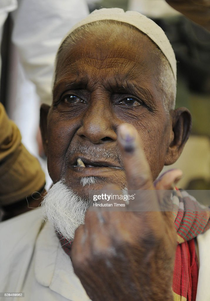 Asgar Ali 103 years old enclave dweller showing his ink stained finger after casting his vote for the first time at Maddhya Mashaldanga, Chhitmahal on May 5, 2016 in Coochbehar, India. More than 9,800 of the 10,100 eligible voters in former Bangladeshi enclaves of West Bengals Cooch Behar have enrolled for the voter list, signalling exceptional enthusiasm among the people who became Indian citizens less than nine months ago. These people have lived in a virtual no-mans land for 68 years because of a complex territorial division, which created enclaves or islands of foreign territory inside each country along the Indo-Bangladesh border. The two countries agreed in 2015 to swap the almost 200 enclaves located in one country but officially belonging to the other.