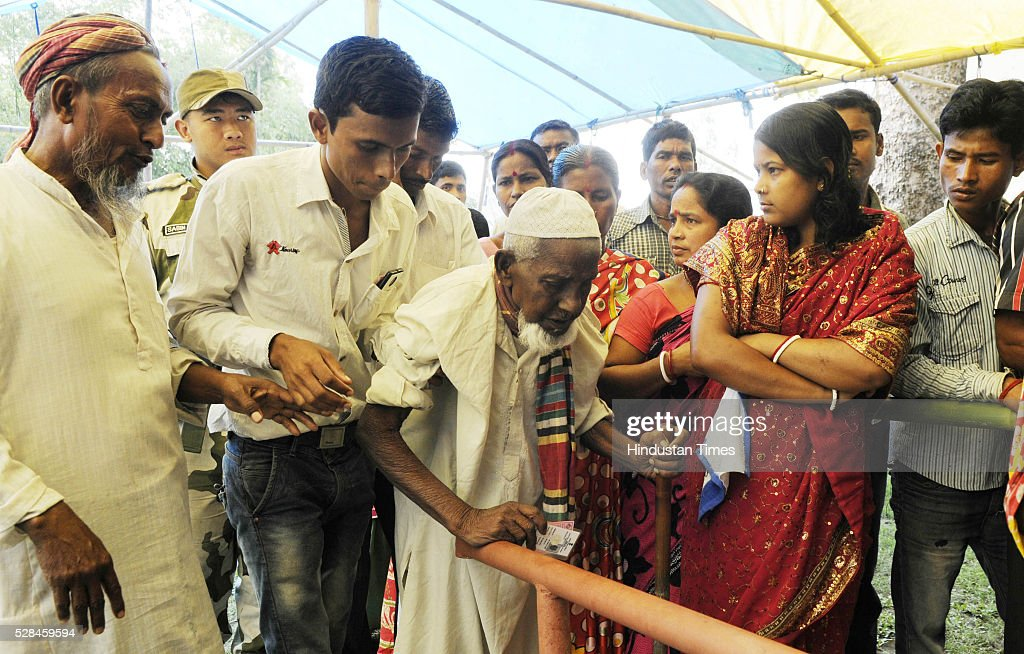 Asgar Ali 103 years old enclave dweller waiting in line at polling station to cast his vote for the first time at Maddhya Mashaldanga, Chhitmahal on May 5, 2016 in Coochbehar, India. More than 9,800 of the 10,100 eligible voters in former Bangladeshi enclaves of West Bengals Cooch Behar have enrolled for the voter list, signalling exceptional enthusiasm among the people who became Indian citizens less than nine months ago. These people have lived in a virtual no-mans land for 68 years because of a complex territorial division, which created enclaves or islands of foreign territory inside each country along the Indo-Bangladesh border. The two countries agreed in 2015 to swap the almost 200 enclaves located in one country but officially belonging to the other.