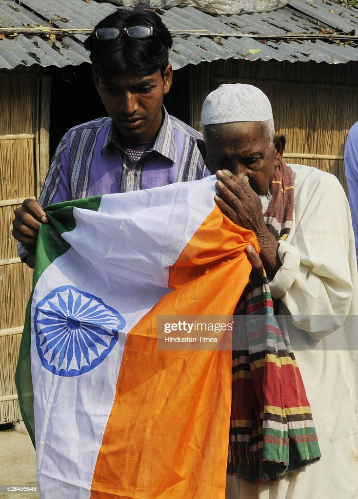 Asgar Ali 103 years old enclave dweller with Indian flag after casting his vote for the first time at Maddhya Mashaldanga, Chhitmahal on May 5, 2016 in Coochbehar, India. More than 9,800 of the 10,100 eligible voters in former Bangladeshi enclaves of West Bengals Cooch Behar have enrolled for the voter list, signalling exceptional enthusiasm among the people who became Indian citizens less than nine months ago. These people have lived in a virtual no-mans land for 68 years because of a complex territorial division, which created enclaves or islands of foreign territory inside each country along the Indo-Bangladesh border. The two countries agreed in 2015 to swap the almost 200 enclaves located in one country but officially belonging to the other.