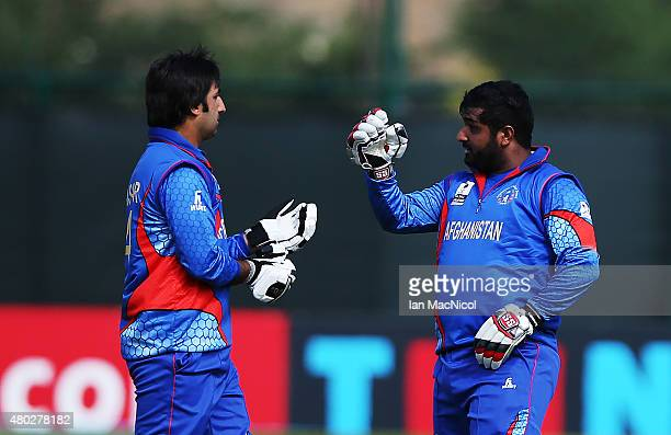 Asghar Stanikai and Shahzad Mohammadi of Afghanistan in action during the ICC World Twenty20 India Qualifier between UAE and Afghanistan at the...