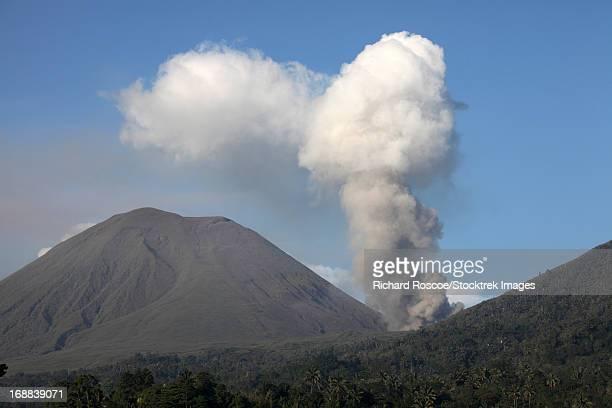 Ash cloud rising from Tompaluan crater at Lokon-Empung volcano.