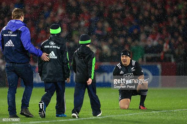 Ash Dixon of the Maori All Blacks presents a shirt to the sons of former Munster Coach Anthony Foley before the friendly match between Munster and...