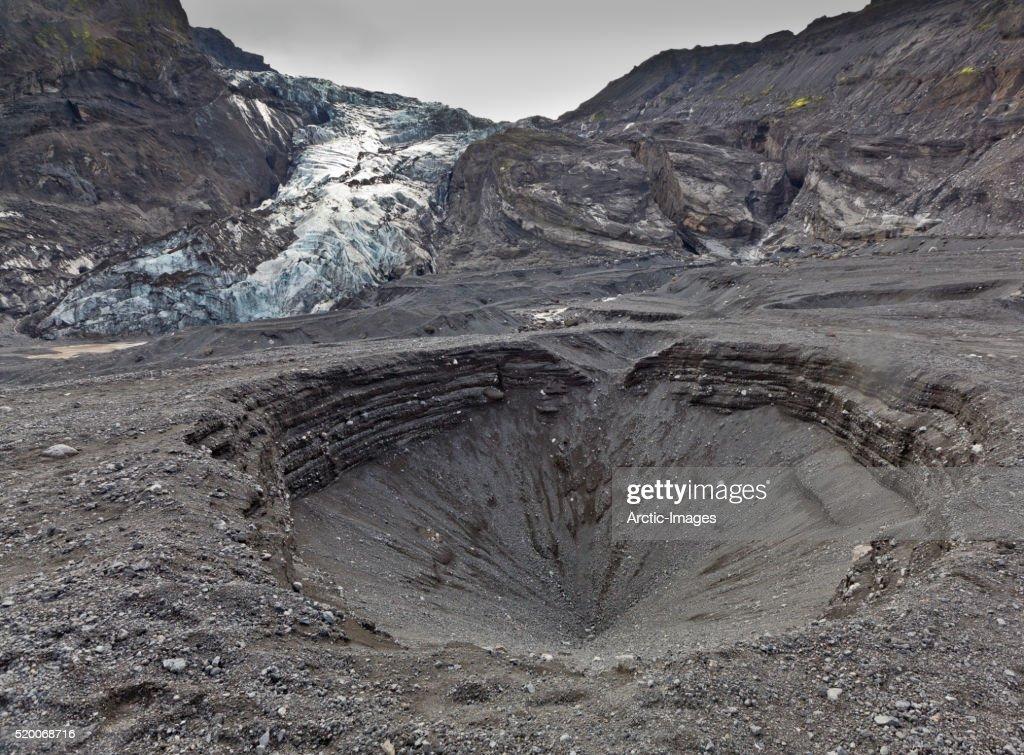 Ash filled landscape with Gigjokull Glacier, Iceland