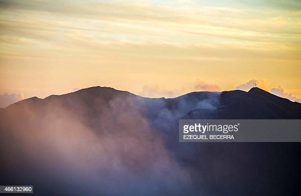 Ash from the Turrialba volcano is seen in the air around San Gerardo de Irazu 65 km northeast of the San Jose on March 13 2015 The volcano showered...