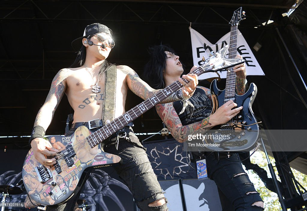 Ash Purdy (L) and Jake Pitts of Black Veil Brides perform as part of the Vans Warped Tour at Shoreline Amphitheatre on June 22, 2013 in Mountain View, California.