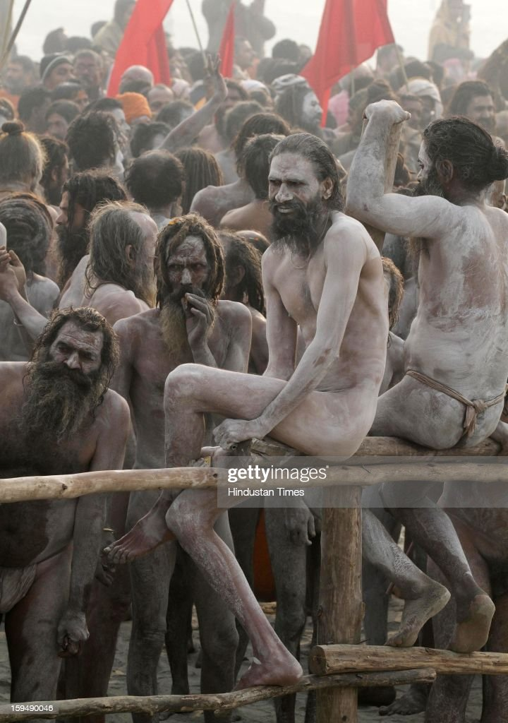 Ash smeared Naga Sadhus prepating to take Shahi Snan (royal bath) at the bank of Sangam confluence of river Ganga, Yamnuna and mythical Saraswati on the occasion of Makar Sankranti on January 14, 2013 in Allahabad, India. Kumbh is World's biggest religious gathering, in which more that 100 million of Hindus and sikh devotees will take part over next 55 days. Apart from being pilgrimage of faith, salvation and hope for millions of devotees, it also serve as meeting ground for the vast spectrum of Indian religious and spiritual views.