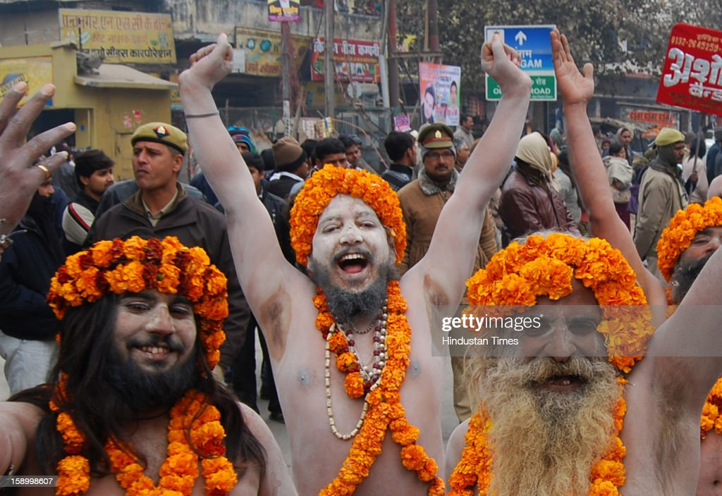 Ash smeared Naga Sashu taking part Royal Peshwai Juloos (procession) of Atal Akhada at the Sangam, confluence of the Rivers Ganges, Yamuna and mythical Saraswati on January 5, 2013 in Allahabad, India. Many Naga Sanyasis don't wear any cloth on their body. The Kumbh Mela is mass Hindu pilgrimage that alternates between four places Allahabad, Haridwar, Ujjain and Nashik every three years. The current Kumbh is scheduled to take place at Allahabad city in January and February 2013 and is expected to be attended by 60 million devotees