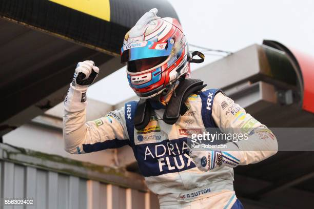 Ash Sutton of Adrian Flux Subaru Racing celebrates winning this years British Touring Car Championship after the final race at Brands Hatch on...