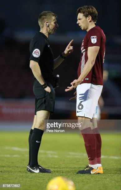 Ash Taylor of Northampton Town is spoken to by referee Michael Salisbury during the Sky Bet League One match between Northampton Town and Scunthorpe...