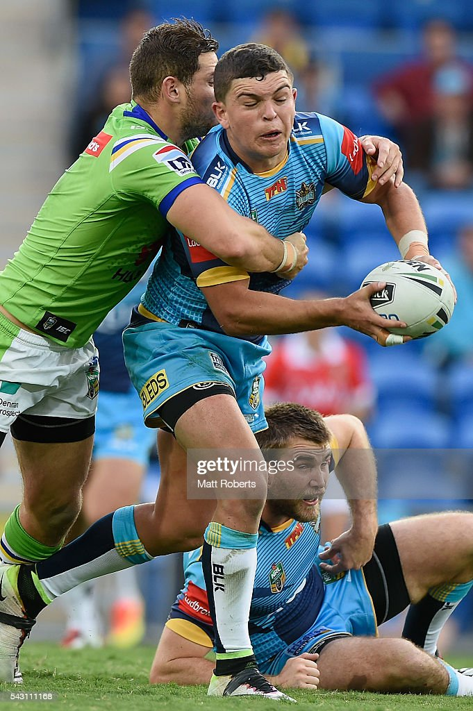 Ash Taylor of the Titans is tackled during the round 16 NRL match between the Gold Coast Titans and the Canberra Raiders at Cbus Super Stadium on June 26, 2016 in Gold Coast, Australia.