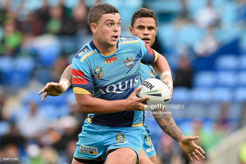 Ash Taylor of the Titans looks to pass the ball during the round 16 NRL match between the Gold Coast Titans and the Canberra Raiders at Cbus Super Stadium on June 26, 2016 in Gold Coast, Australia.