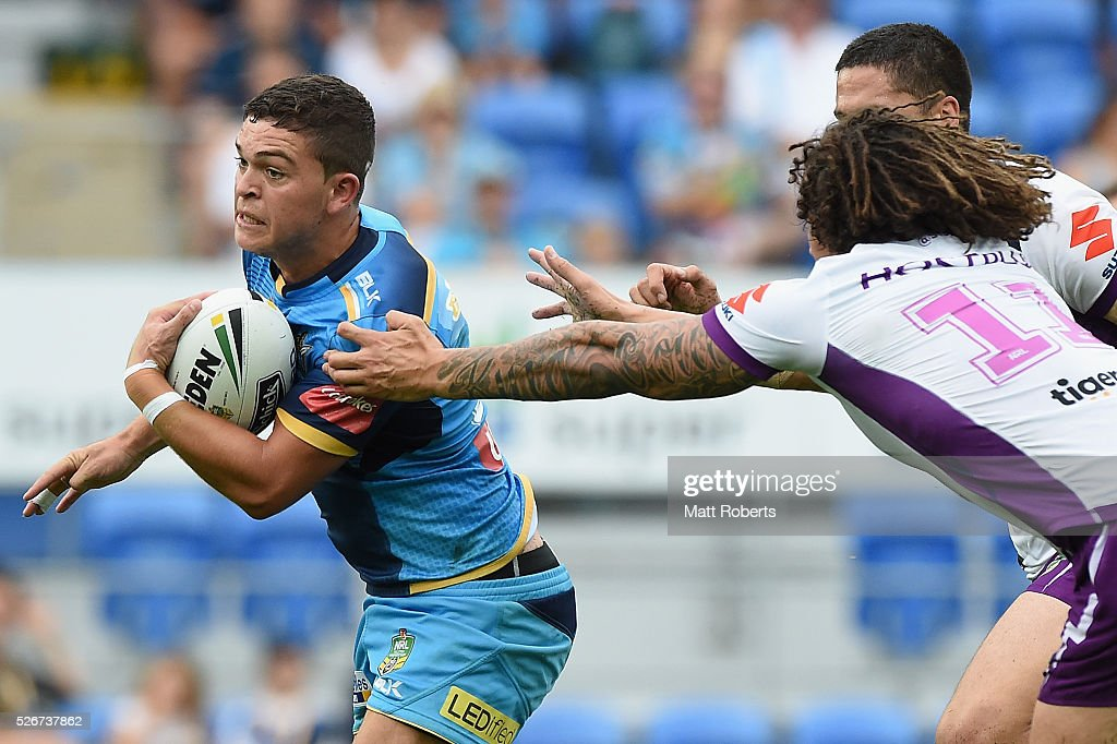 Ash Taylor of the Titans makes a break during the round nine NRL match between the Gold Coast Titans and the Melbourne Storm on May 1, 2016 in Gold Coast, Australia.