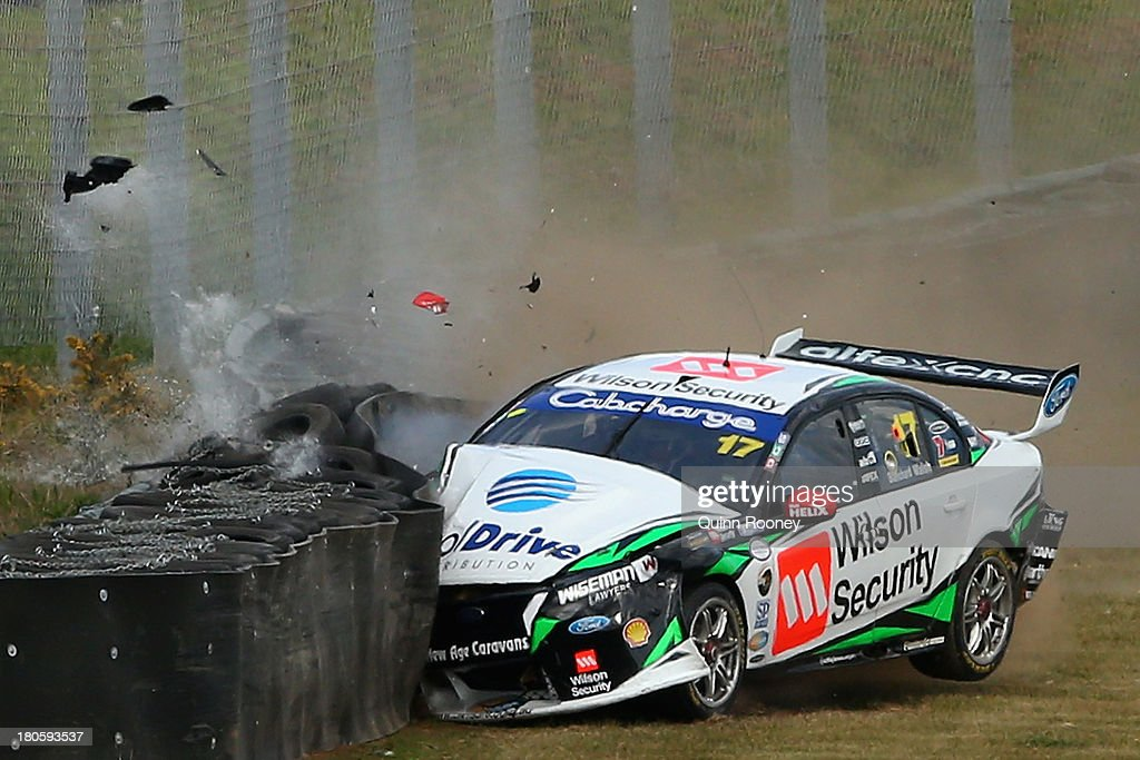 Ash Walsh crashes into a wall in his #17 Dick Johnson Racing Ford during the Sandown 500 race 28, which is round 10 of the V8 Supercar Championship Series at Sandown International Motor Raceway on September 15, 2013 in Melbourne, Australia.