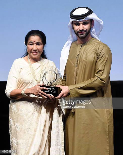 Asha Bhosle on stage as she receives the Lifetime Achievement award from HH Sheikh Mansoor bin Mohammed bin Rashid Al Maktoum at the Opening Night...