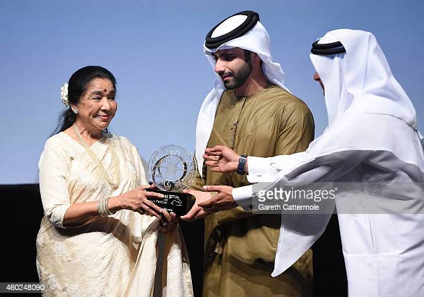 Asha Bhosle on stage as she receives the Lifetime Achievement award from HH Sheikh Mansoor bin Mohammed bin Rashid Al Maktoum and DIFF Chairman...