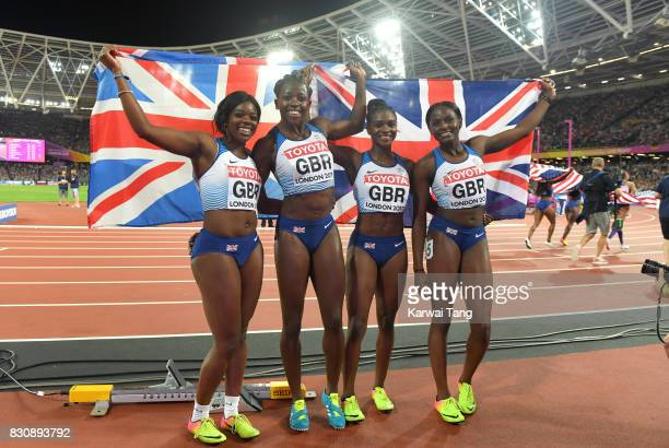 Asha Philip Deriree Henry Dina AsherSmith and Daryll Neita of Great Britain celebrate winning silver in the Women's 4x100 Metres Final during day...