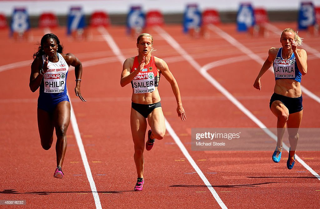 Asha Philip of Great Britain and Northern Ireland, Verena Sailer of Germany and Hanna-Maari Latvala of Finland compete in the Women's 100 metres heats during day one of the 22nd European Athletics Championships at Stadium Letzigrund on August 12, 2014 in Zurich, Switzerland.