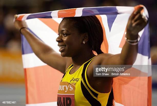 Asha Philip of Newham celebrates winning the Women's 60m during day 1 of the Sainsbury's British Athletics Indoor Championships at the England...