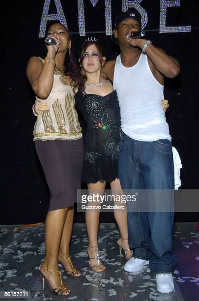 Ashanti and JaRule pose with Amber Ridinger at the Forge at Amber Ridinger's Bat Mitzvah on November 12 2005 in Miami Beach Florida