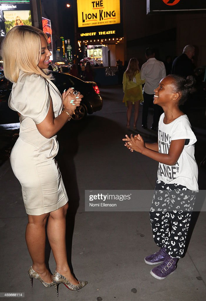 Ashanti and Kaci Walfall attend 'The Lion King' on Broadway on September 18 2014 in New York City