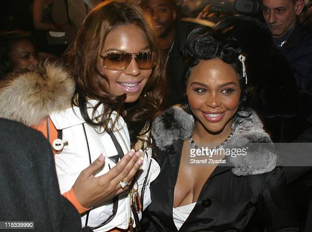 Ashanti and Lil Kim during Olympus Fashion Week Fall 2005 Sweetface by Jennifer Lopez and Andy Hilfiger Front Row at The Tent Bryant Park in New York...
