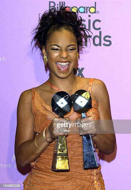 Ashanti poses with two of her eight Billboard Awards